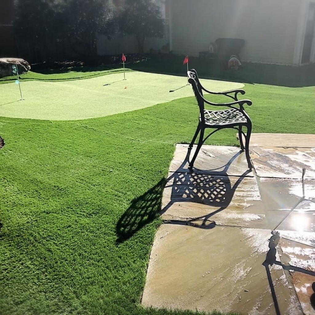 Private Backyard with Installed Putting Greens
