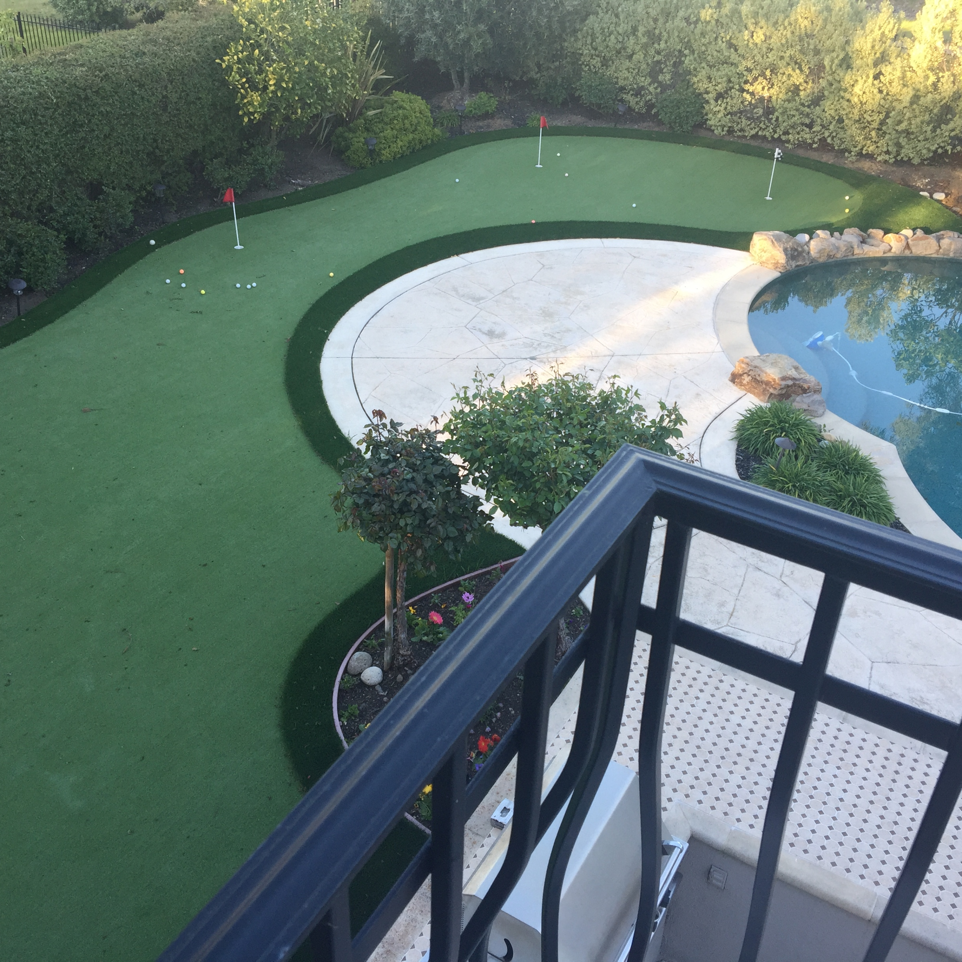 Looking at my artificial grass putting greens from my balcony! Putt-60 Bi-color review. Photo by Robert Anderson Dec 13 2:25 PM