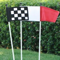 Golf putting greens flag poles. Synthetic turf.