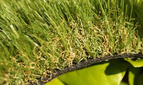 Synthetic turf grass green olive brown fake thatch multi-colored black backing for landscapes playgrounds lawns sports fields