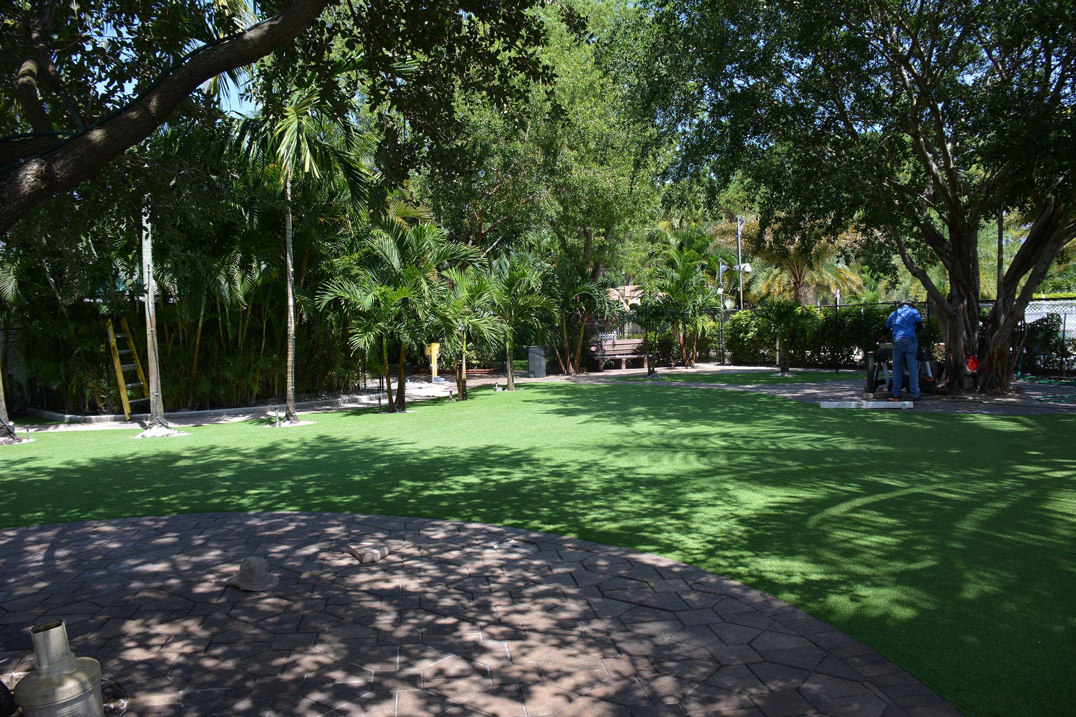 Synthetic lawn artificial grass turf lawn forest backyard landscaping ideas trees.