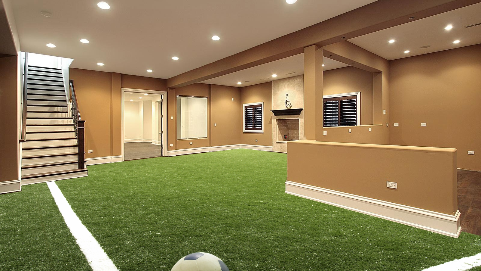 Basement with synthetic turf football