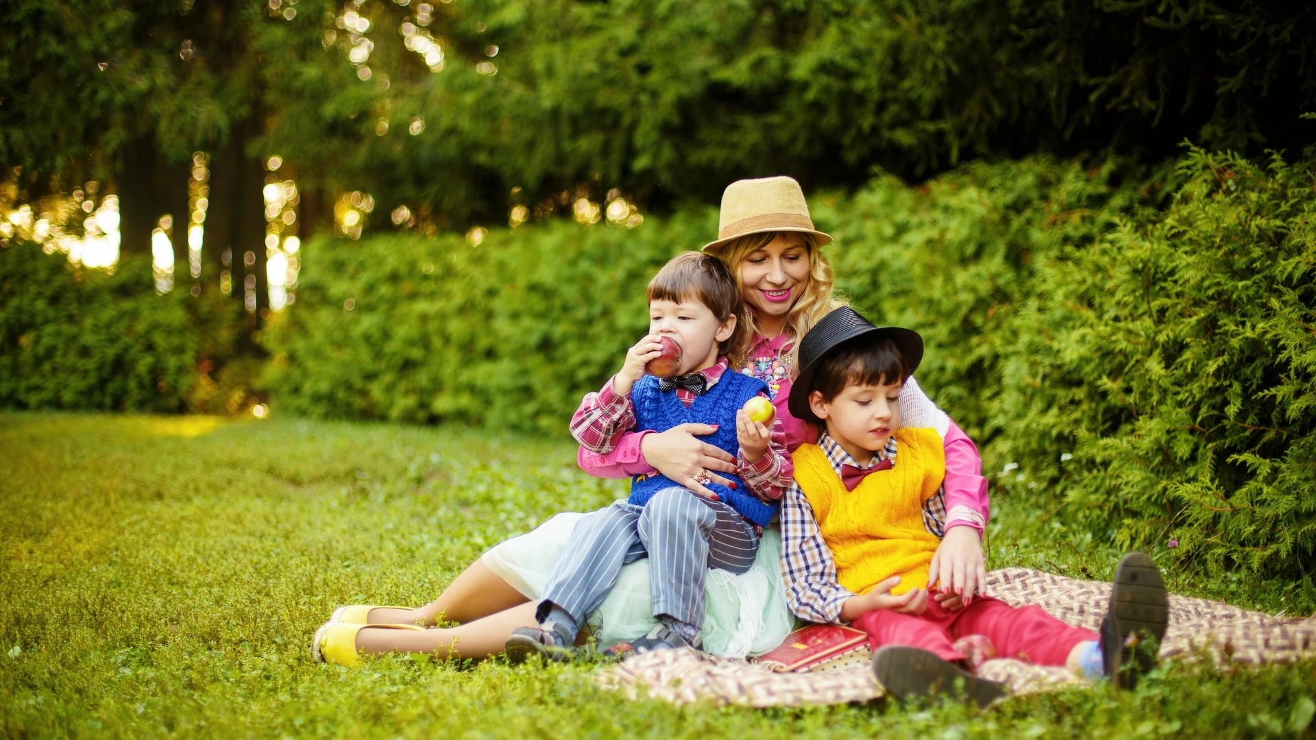 Mother with kids on lawn grass