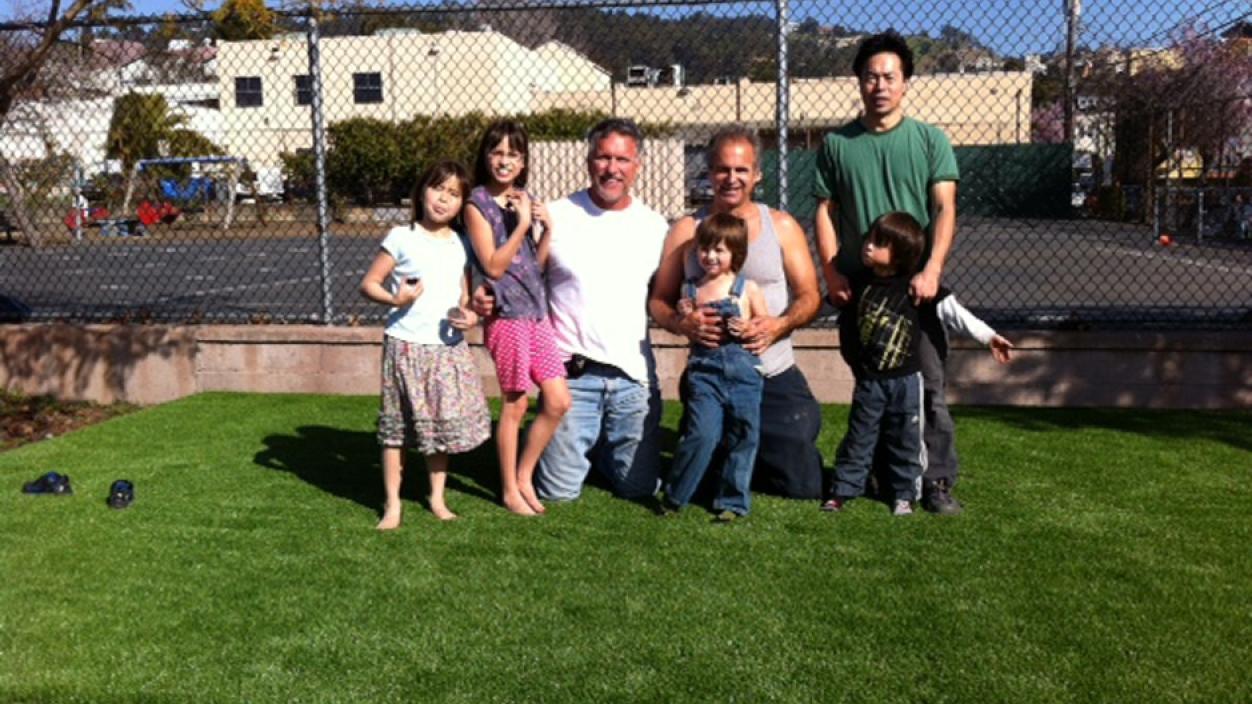 Artificial grass family four children kids synthetic lawn turf backyard