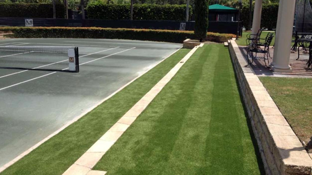 tennis court artificial grass installation, tennis ideas, green carpet outdoor, palm trees blue sky, concrete surface, stone