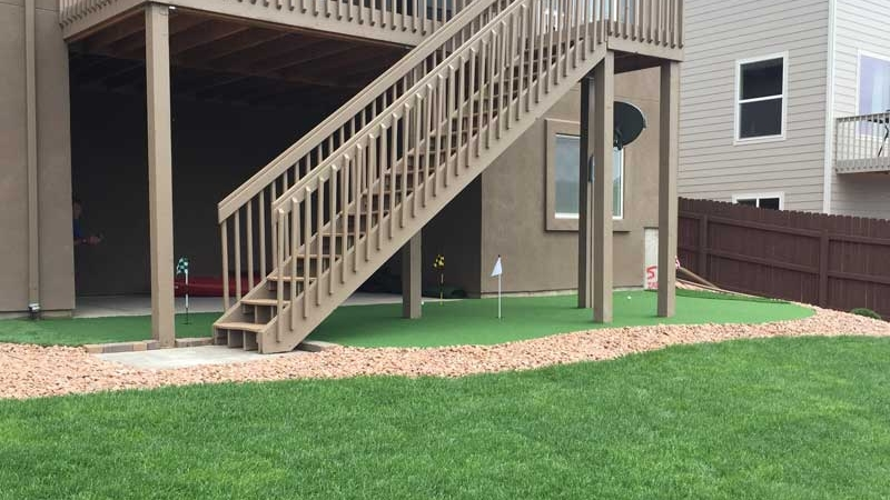 Backyard Putting Green Artificial Turf Putting Greens Home Indoor Outdoor Grass Carpet Office Golf Practice DIY Golf Green under stairs second floor balcony beige staircase landscape fence