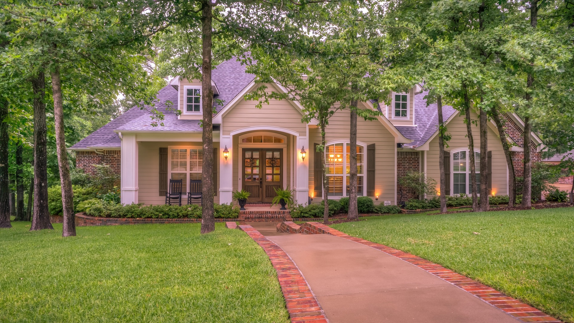 House with synthetic turf front yard lawn pavers bricks