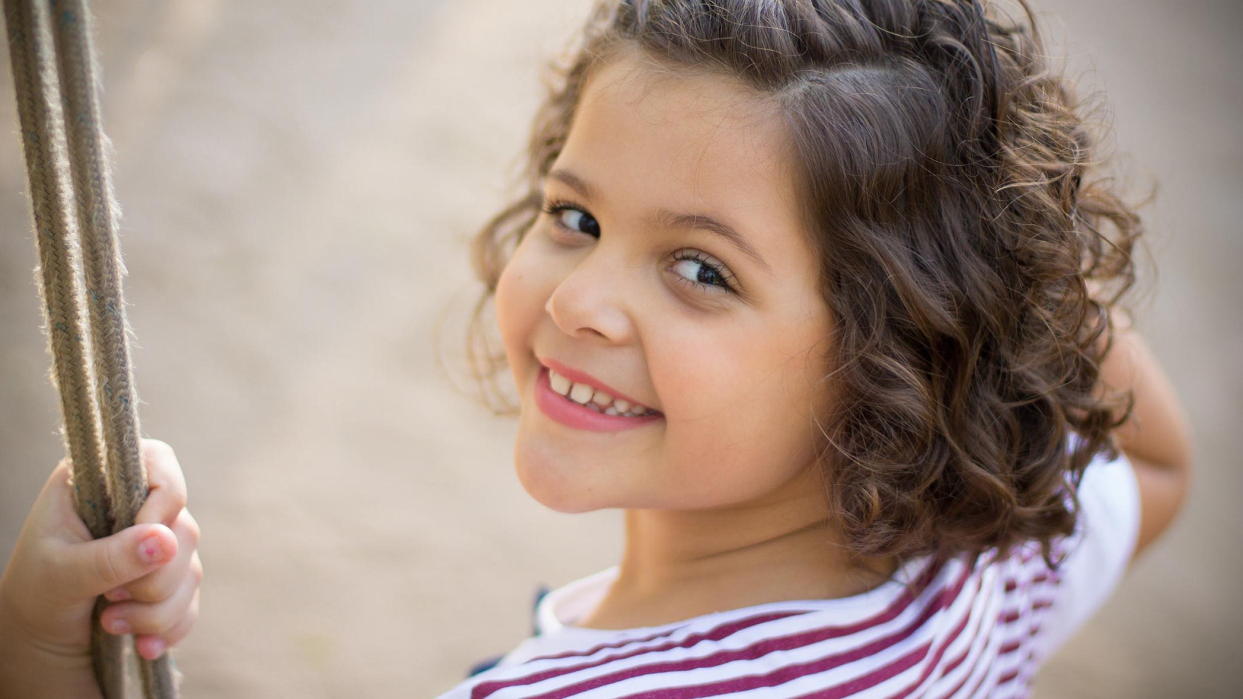 Playground Safety First - Kid on Swing Set