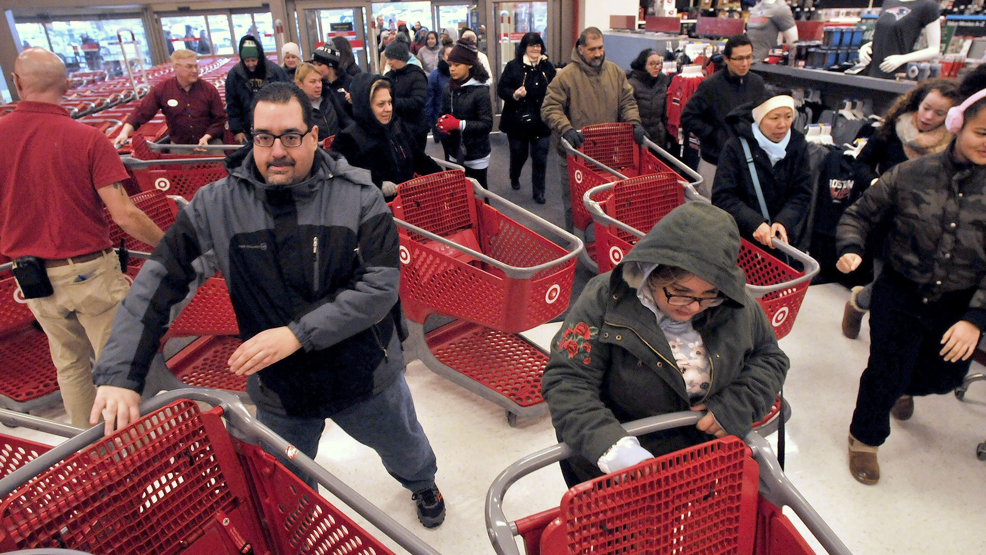 Frantic Black Friday shoppers wrestle over kitchenware, topple TVs to score deals