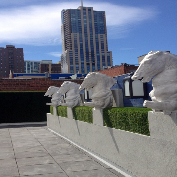 Roof deck patio horses statues artificial grass concrete tiles roof garden