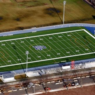 football field synthetic grass green grass blue borders