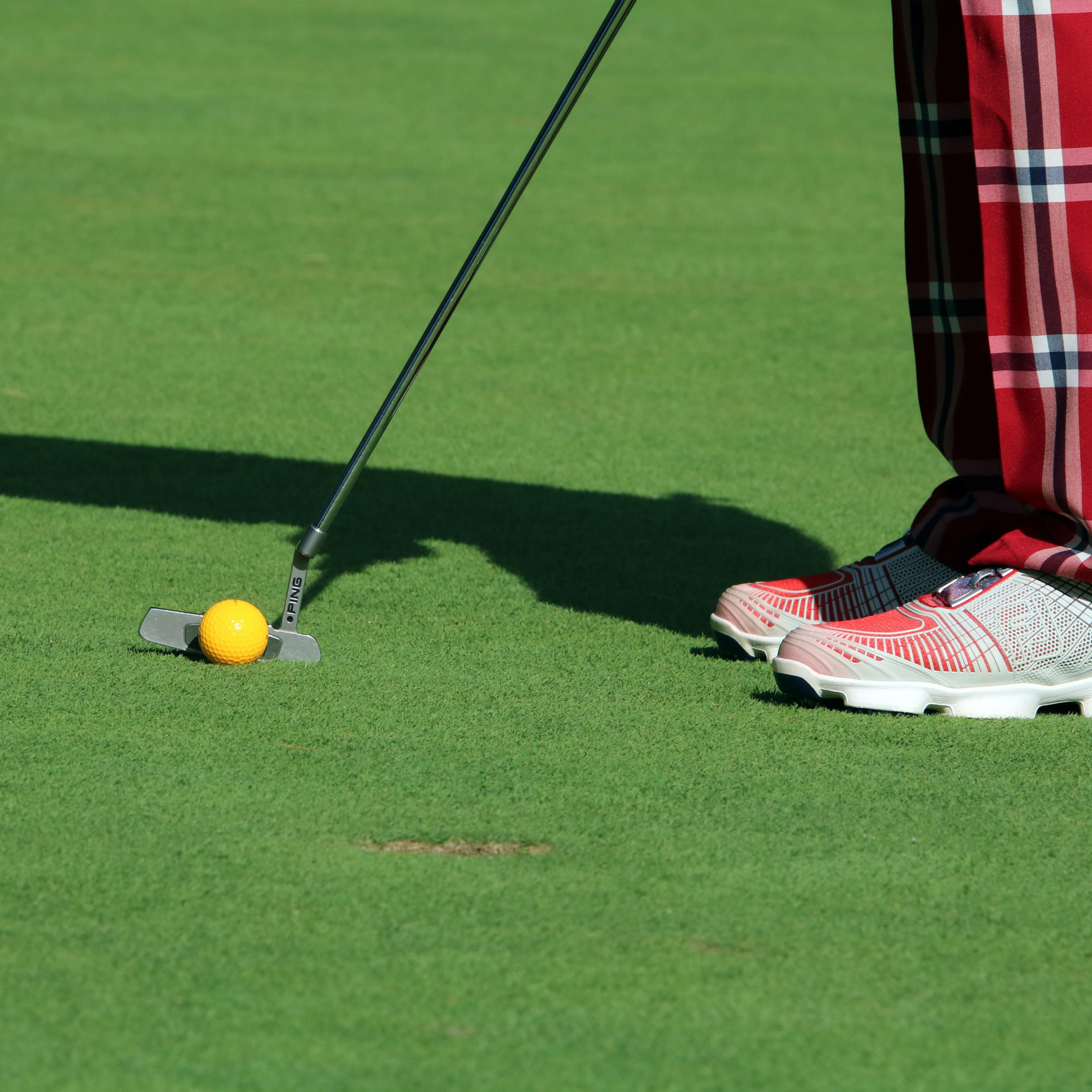 golf player on putting greens synthetic turf