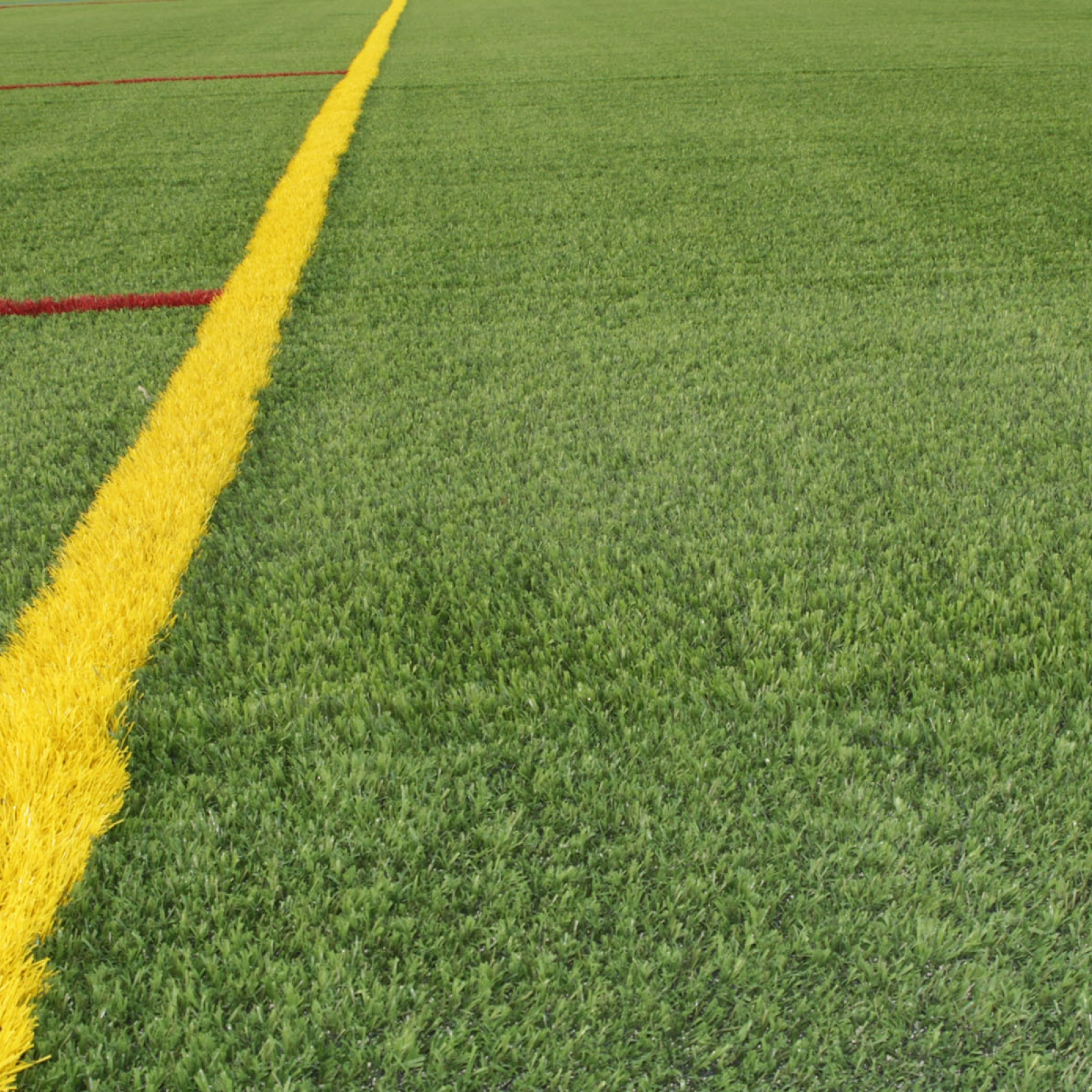 Sports stadium synthetic turf yellow line red line green turf multi-purpose field green grass artificial fake grass
