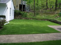 Artificial grass synthetic green lawn forest trees backyard lawn walkway hill