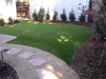 Artificial grass installation pavers stepping stones walkway synthetic turf backyard landscaping lawn landscape