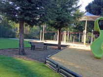 Public park playground artificial grass installation synthetic turf lawn grass sand playgrounds surface ambrellas