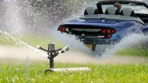 Water sprinkler, car in water, California water fines