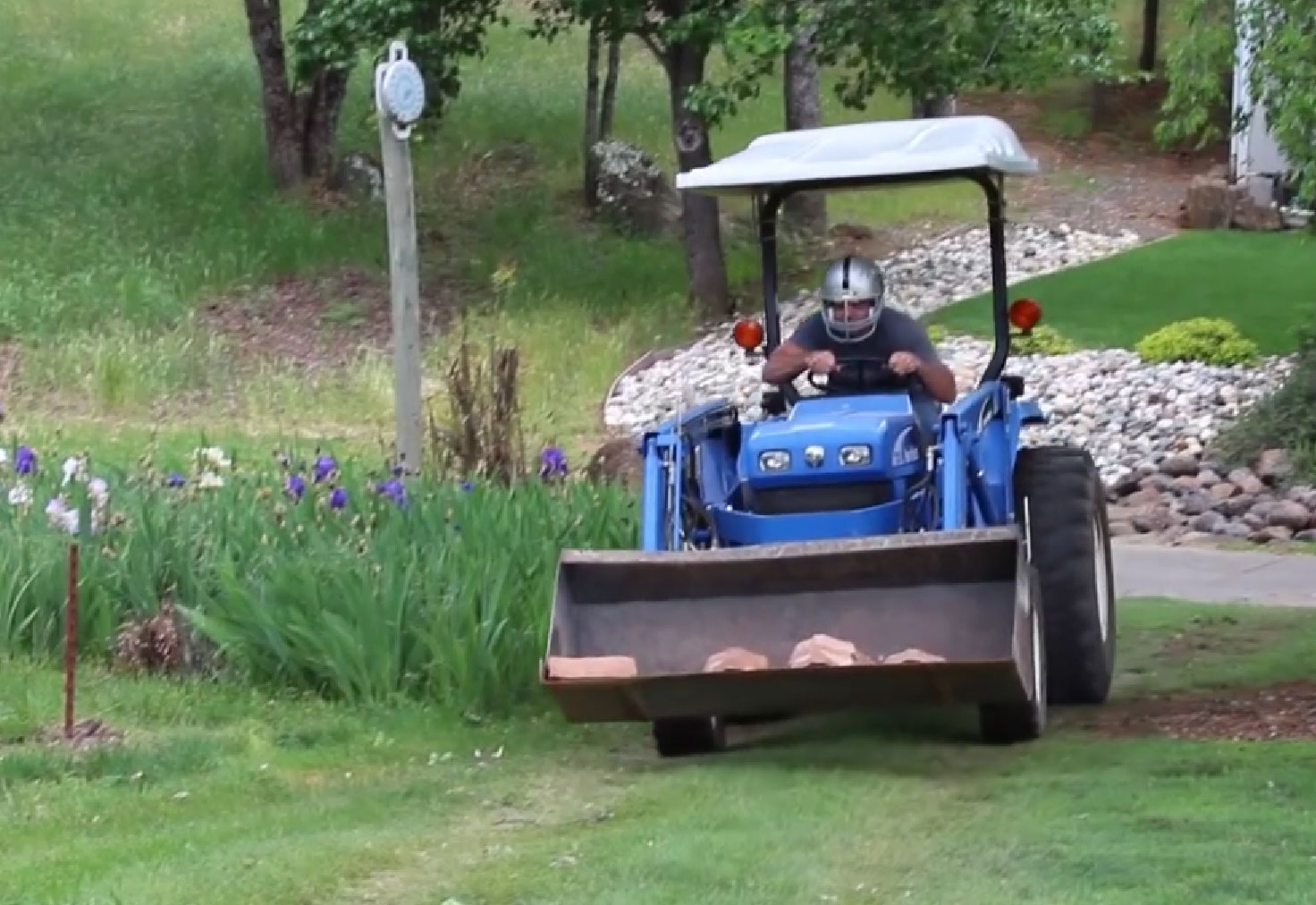 Base installation riding blue truck artificial grass