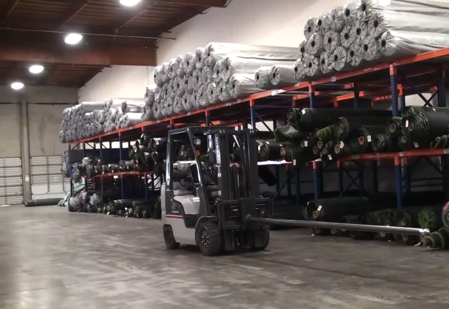 Artificial Grass Warehouse rolls forklift