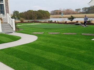 Landscape made with putting green artificial grass by the lake in Carolina