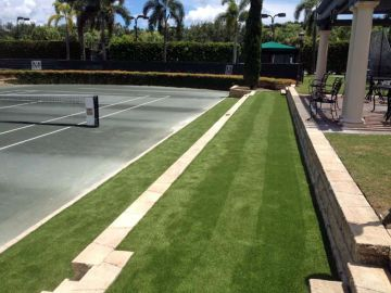 tennis court artificial grass installation, tennis ideas, green carpet outdoor, palm trees blue sky, concrete surface, stone