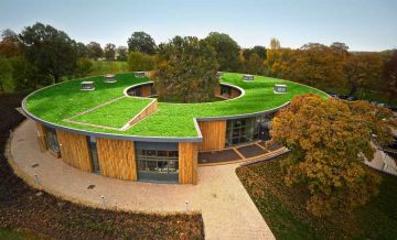 artificial grass rooftop,green roof,greenery roof,round building,artificial grass,synthetic turf,tree roof,roof garden,fake grass