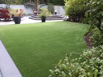Backyard artificial grass installation with always green turf waterless safety lead-free grass landscaping ideas