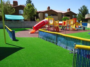 Playground surfacing or flooring, Sand, mulch, gravel, rubber, rubber tiles, mats, crumbs, artificial grass pros and cons, cost, safety, design. Green grass synthetic fake playground.