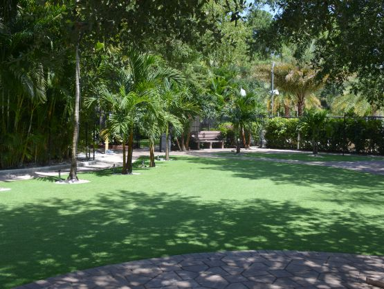 Green artificial grass synthetic turf installed on a big property park