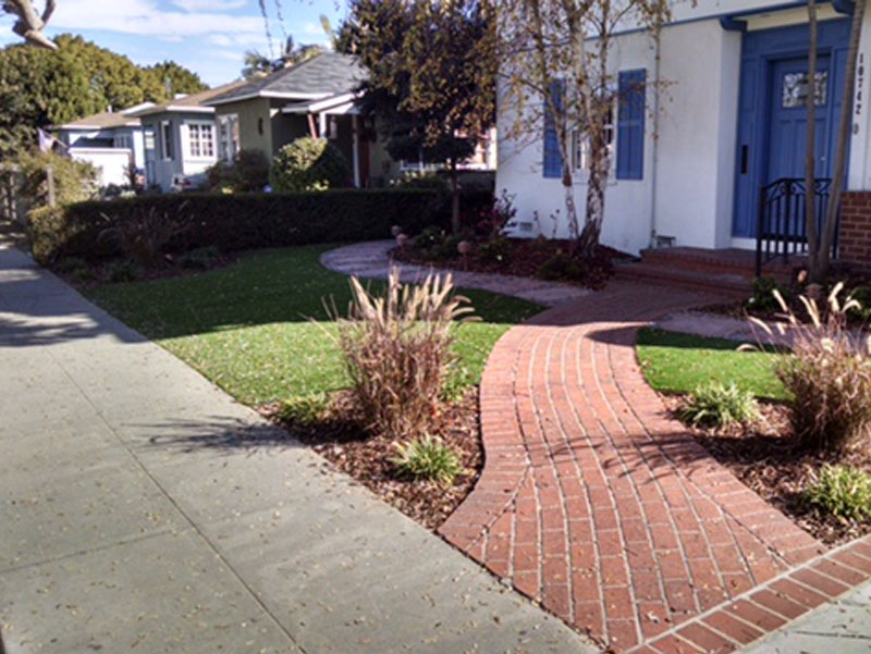 Front yard landscaping ideas stones bricks artificial grass drought landscape Rubidoux, California
