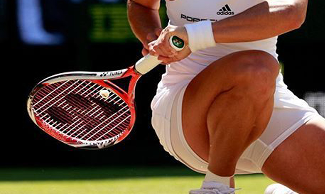Wimbledon player, racket, grass court