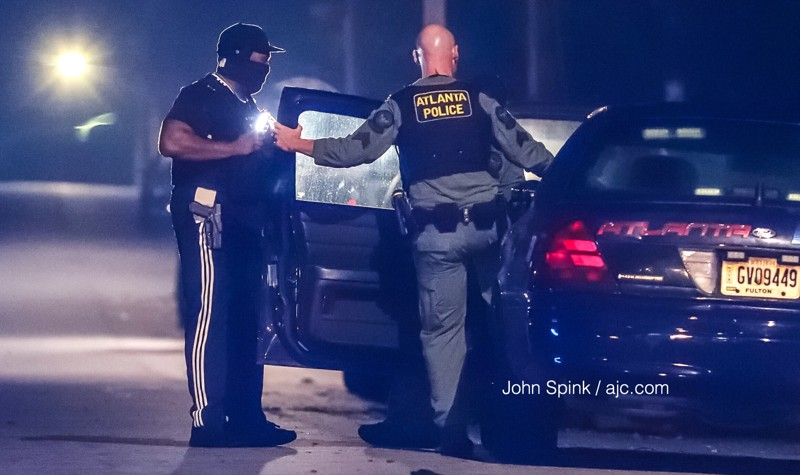NEW DETAILS: Search continues for gunman after shots fired at cop car, SWAT standoff