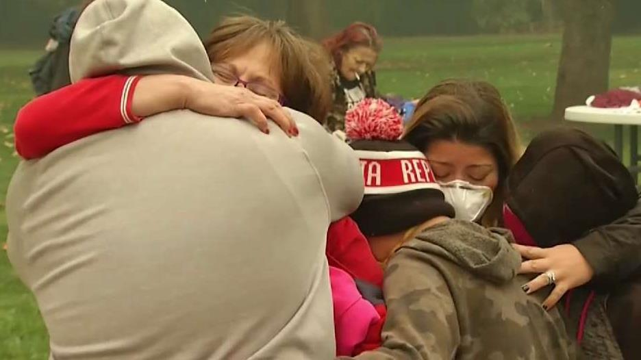 Families Reunite After Fleeing From Deadly Wildfire